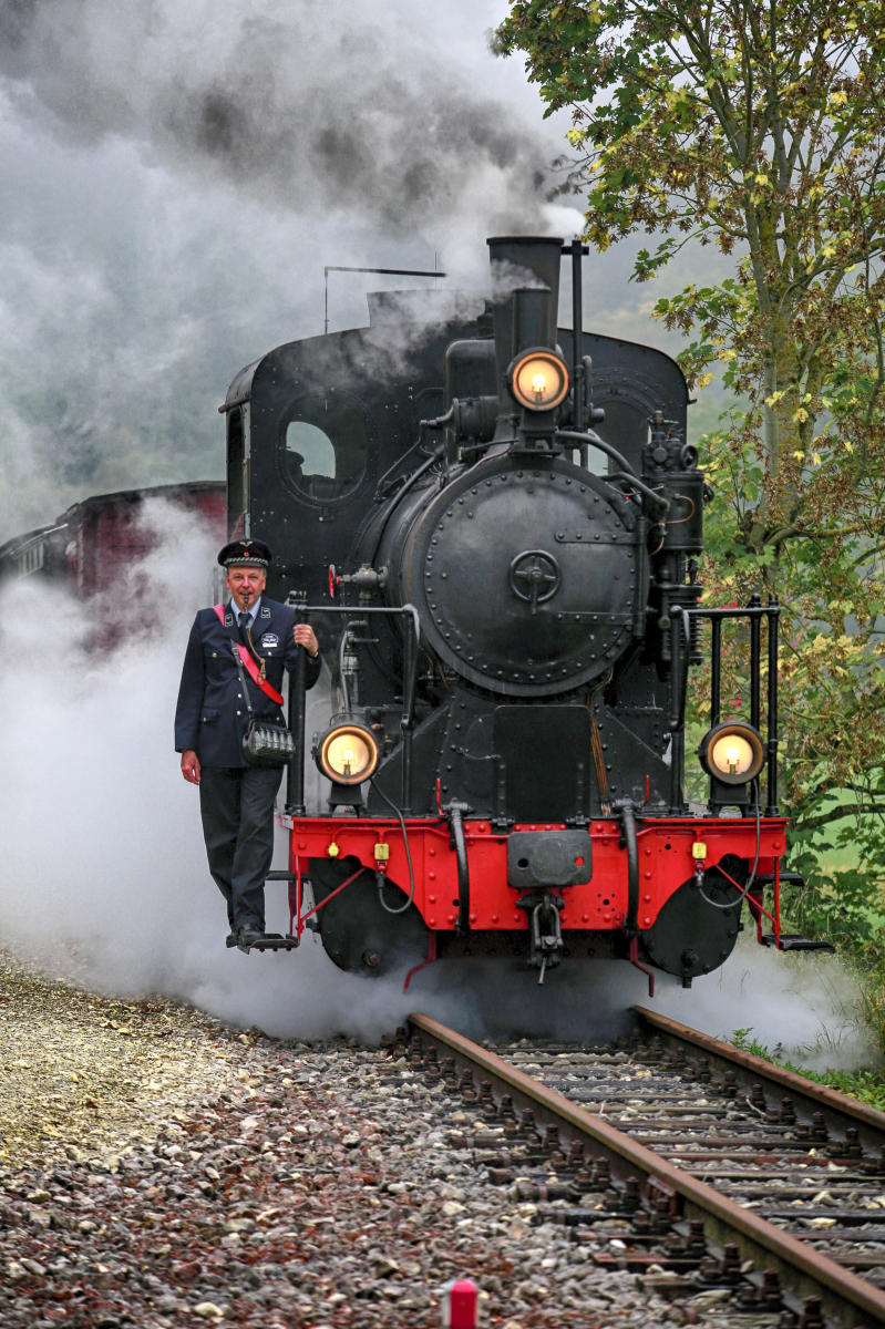 Railroad enthusiasts keep an old steam engine running in Neresheim, Germany.