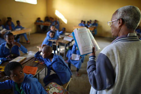 Less than a week after his surgery, Gebretsahme WeldeSelase is teaching classes again at Kindeya Elementary School. He is no longer slouching and monosyllabic; with text book in hand, he takes command of the class, noticeably energized.
