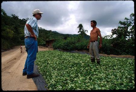 USAID officer questions a coca farmer in the Apurimac River Valley, Peru.