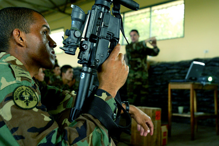 U.S. Special Forces teaching the proper use of M4 assault rifle to Colombian military.