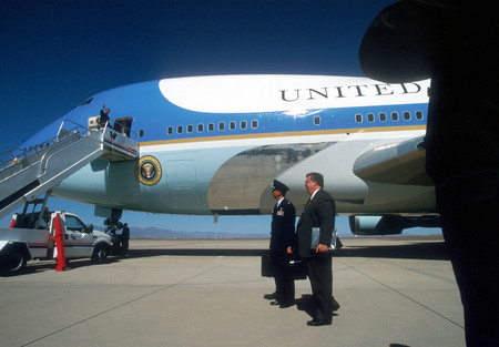 President G.W. Bush, boarding Air force One for a trip to California.