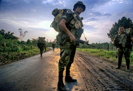Colombian anti-narcotics military personnel on a dawn patrol through the Putumayo region.