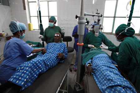 Dr. Tilahun, of Ethiopia, will be performing the surgery on Gebretsahme today. He finishes up on another patient as Gebre is laid out on the gurney. The procedure for both eyes is completed under 20 minutes.