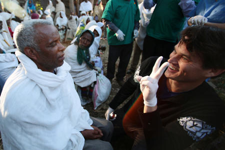 Dr. Matt Oliva, of the Himalayan Cataract Project removes Gebre's patches and examines his eyes as he counts fingers and sees for the first time in over a year.