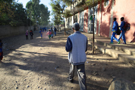 After choosing some sunglasses, Gebre walks to the school where he taught before his cataracts matured into blindness. He would like to start teaching asap.